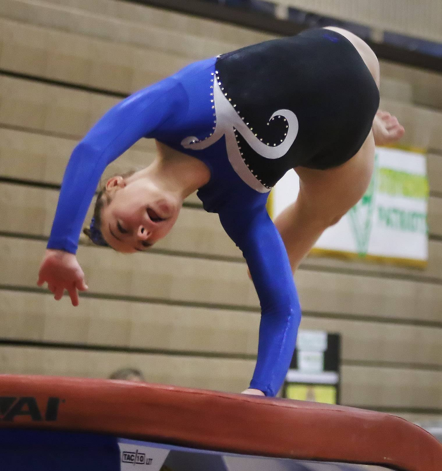Wheeling's Anna Emery performs on the vault during the regional meet hosted by Carmel Catholic on Thursday.