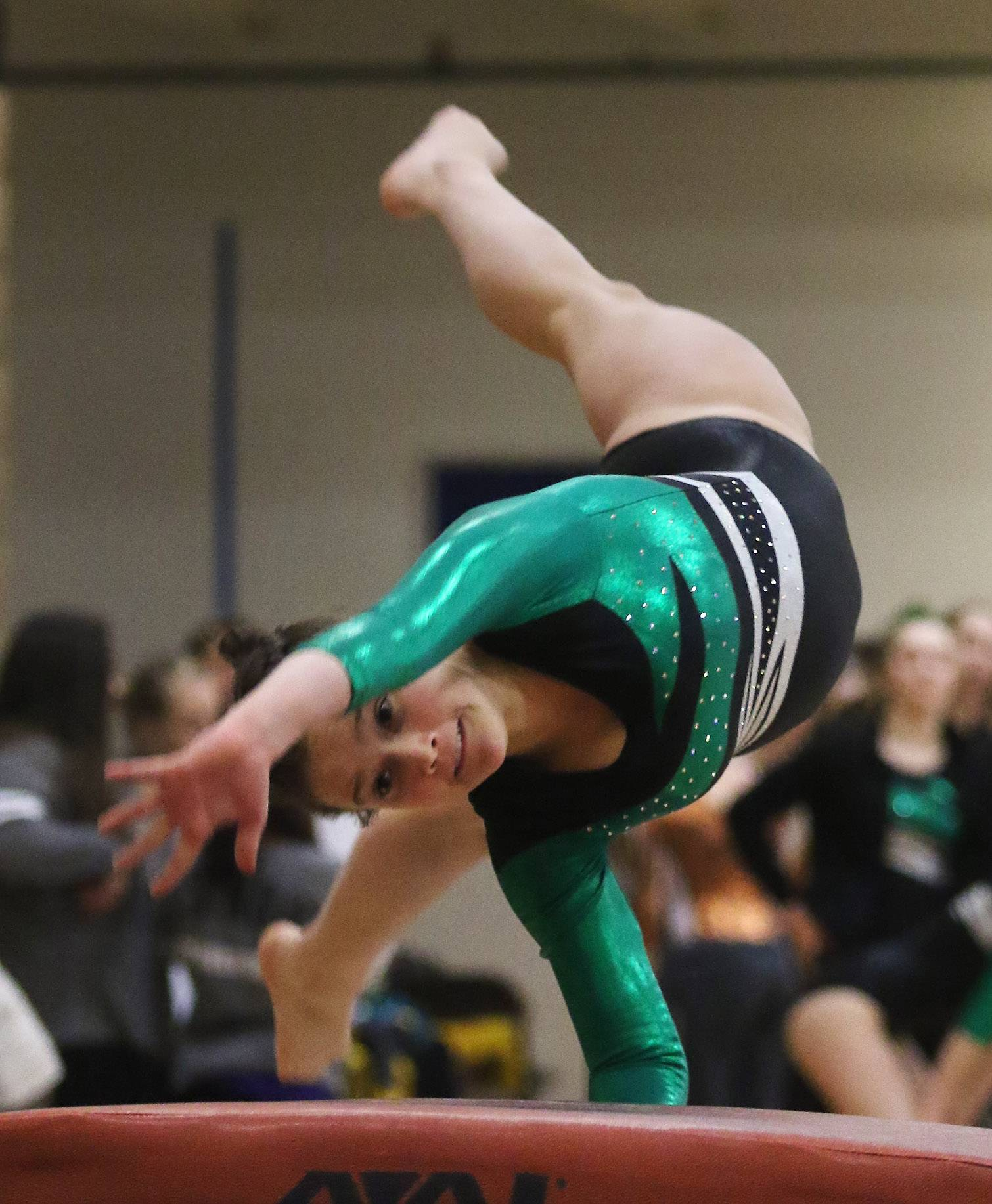 Stevenson's Emily Weinstein performs on the vault during regional meet hosted by Carmel Catholic on Thursday.