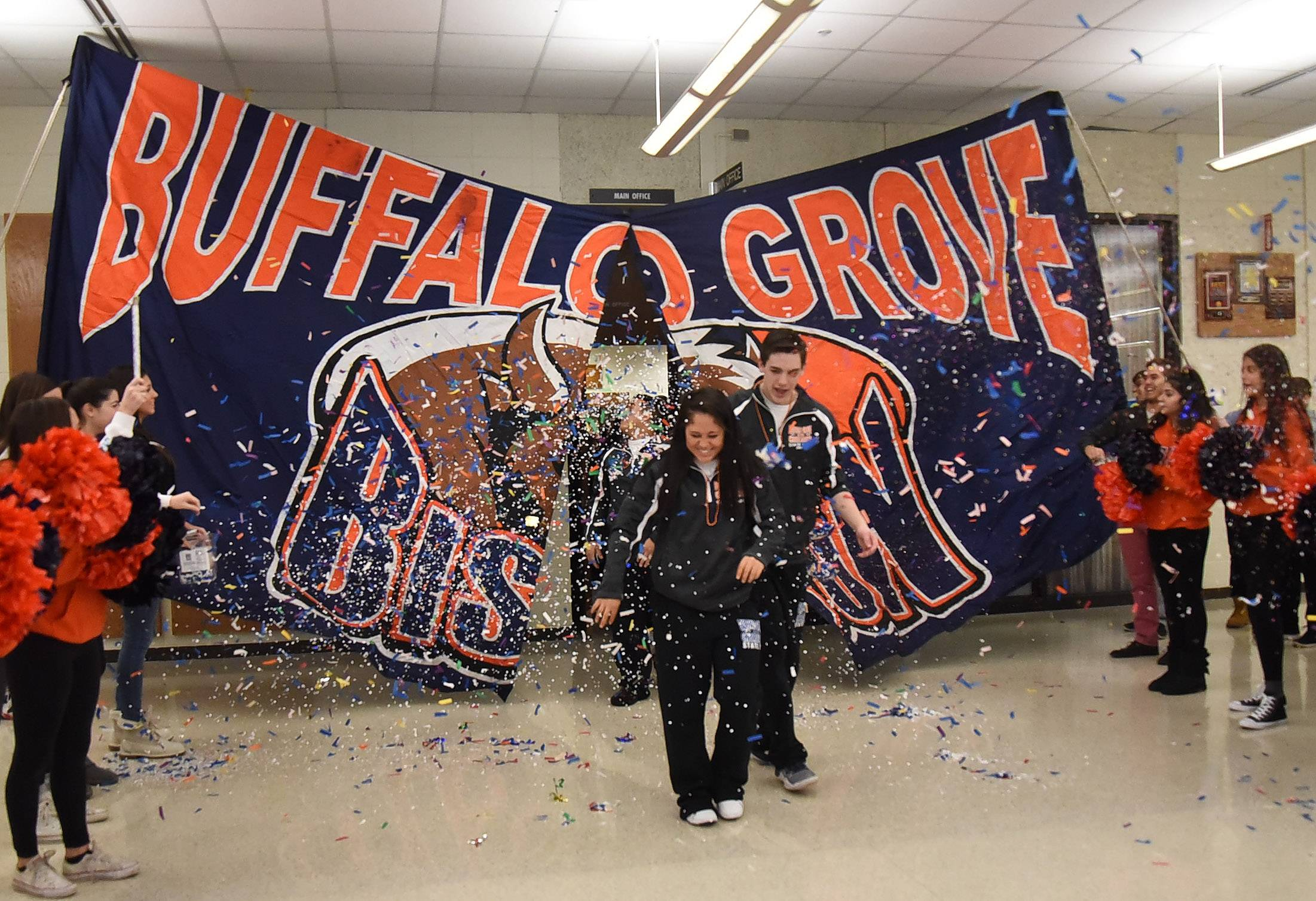 Karson McEwen and Christopher Benson lead the way as cheerleaders at Buffalo Grove High School get a pep rally to send them off to state finals.
