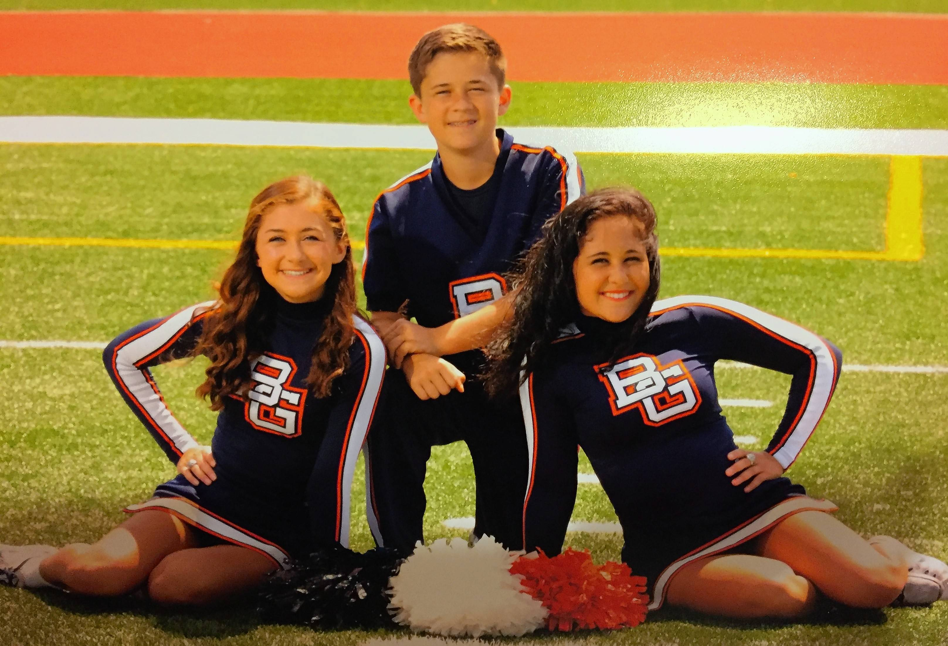 Buffalo Grove High School's cheerleading squad, hoping for a three-peat at this weekend's IHSA state championships, already has one threesome: siblings junior Kennedy McEwen, right, freshman Bobby McEwen and senior Karson McEwen.