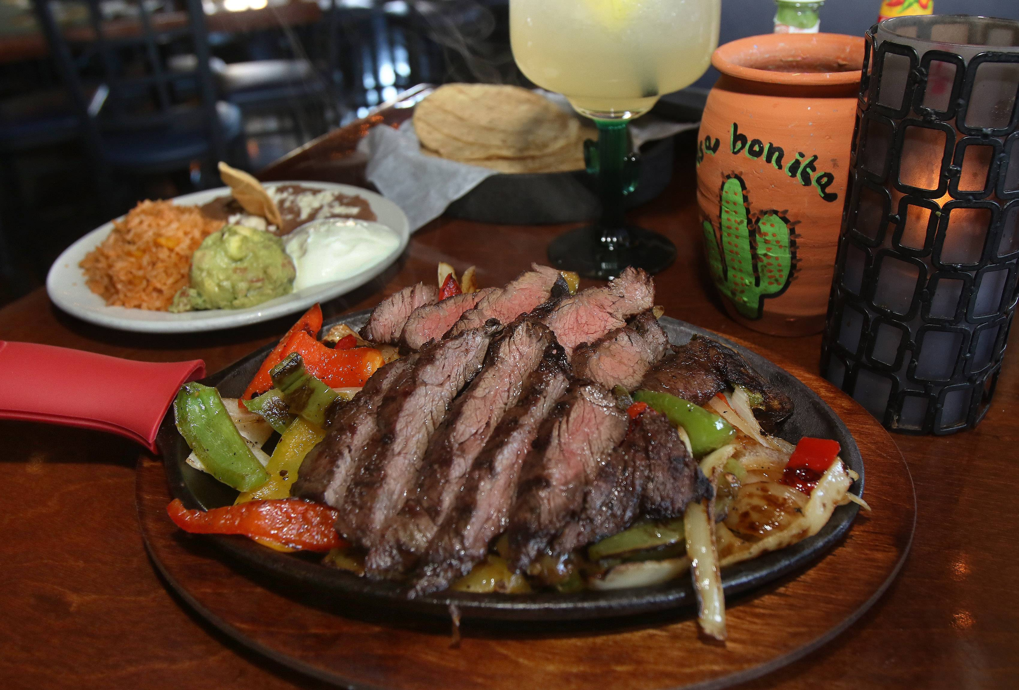 Skirt steak fajitas, with sauteed red and green peppers and onions, arrives on a sizzling platter at Casa Bonita in Libertyville.