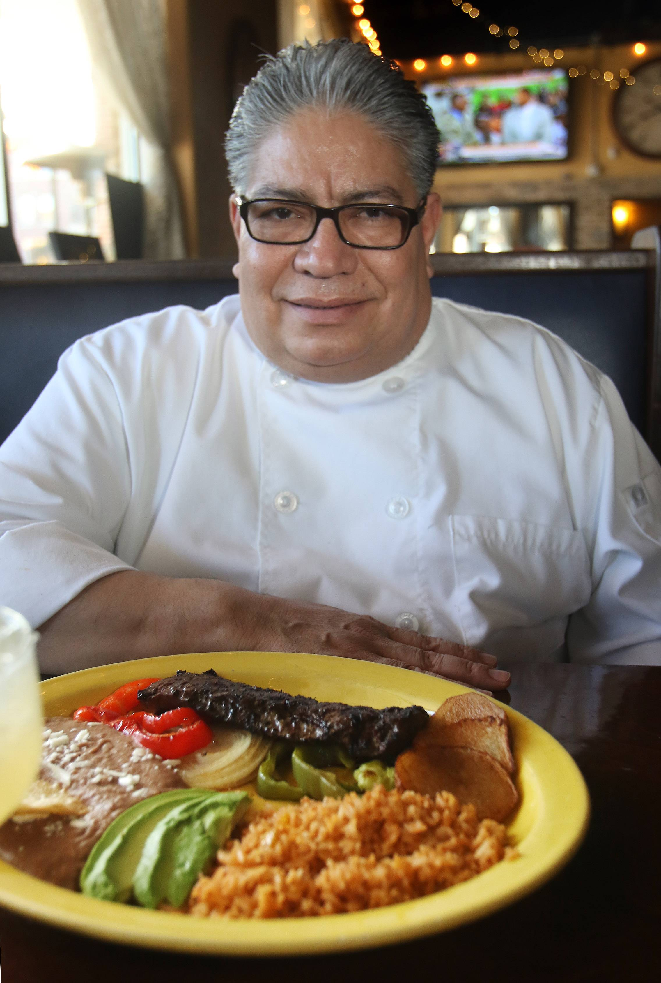 Casa Bonita chef Tino Almaraz shows off the carne asada.