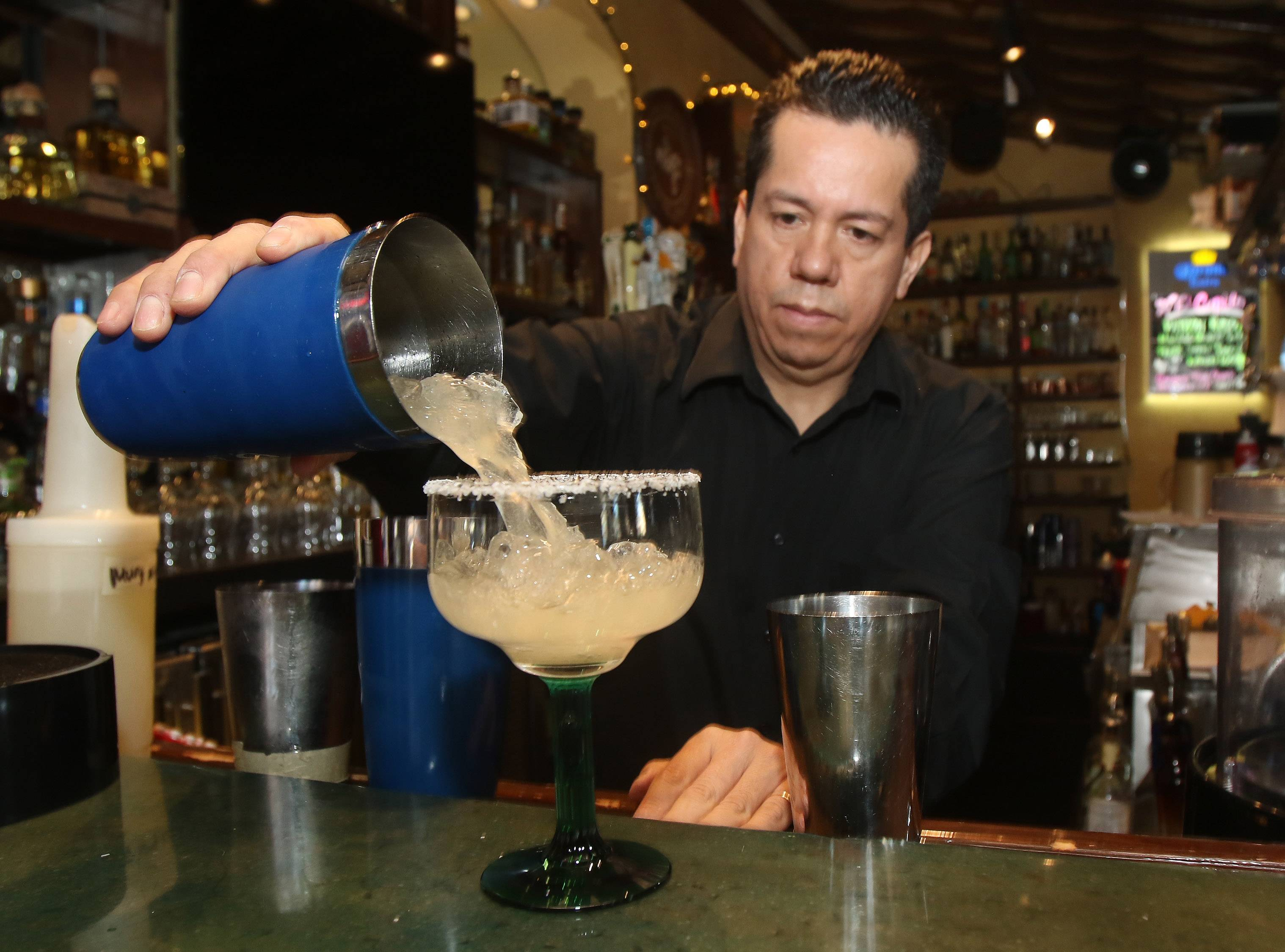 Bartender/mixologist Amado Navarrete makes a Casa Bonita margarita at the Libertyville restaurant.