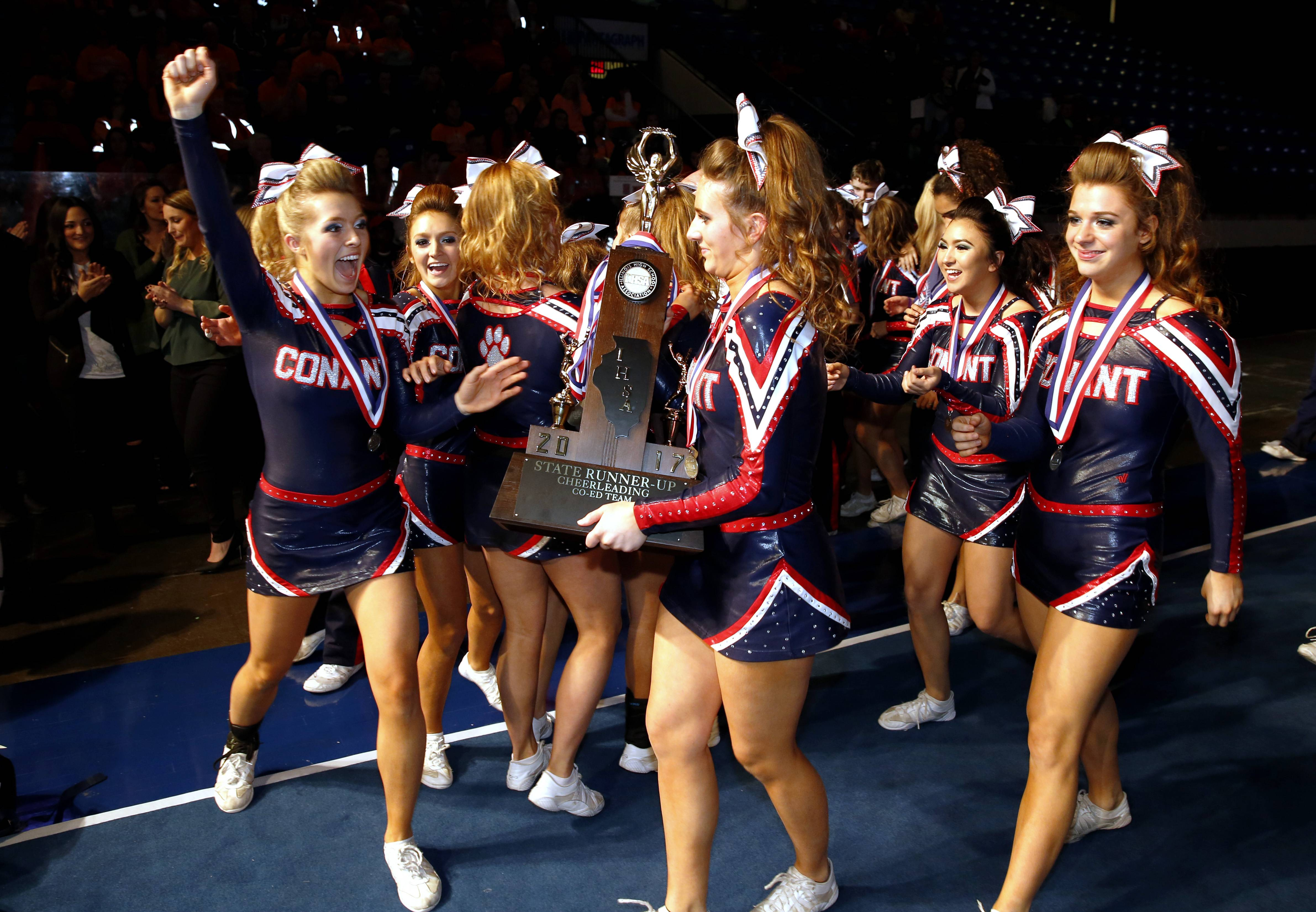 """To walk away with second place is a dream come true,"" Conant coach Amanda Schweinebraten said of her squad's performance. Here, the team celebrates with the trophy."