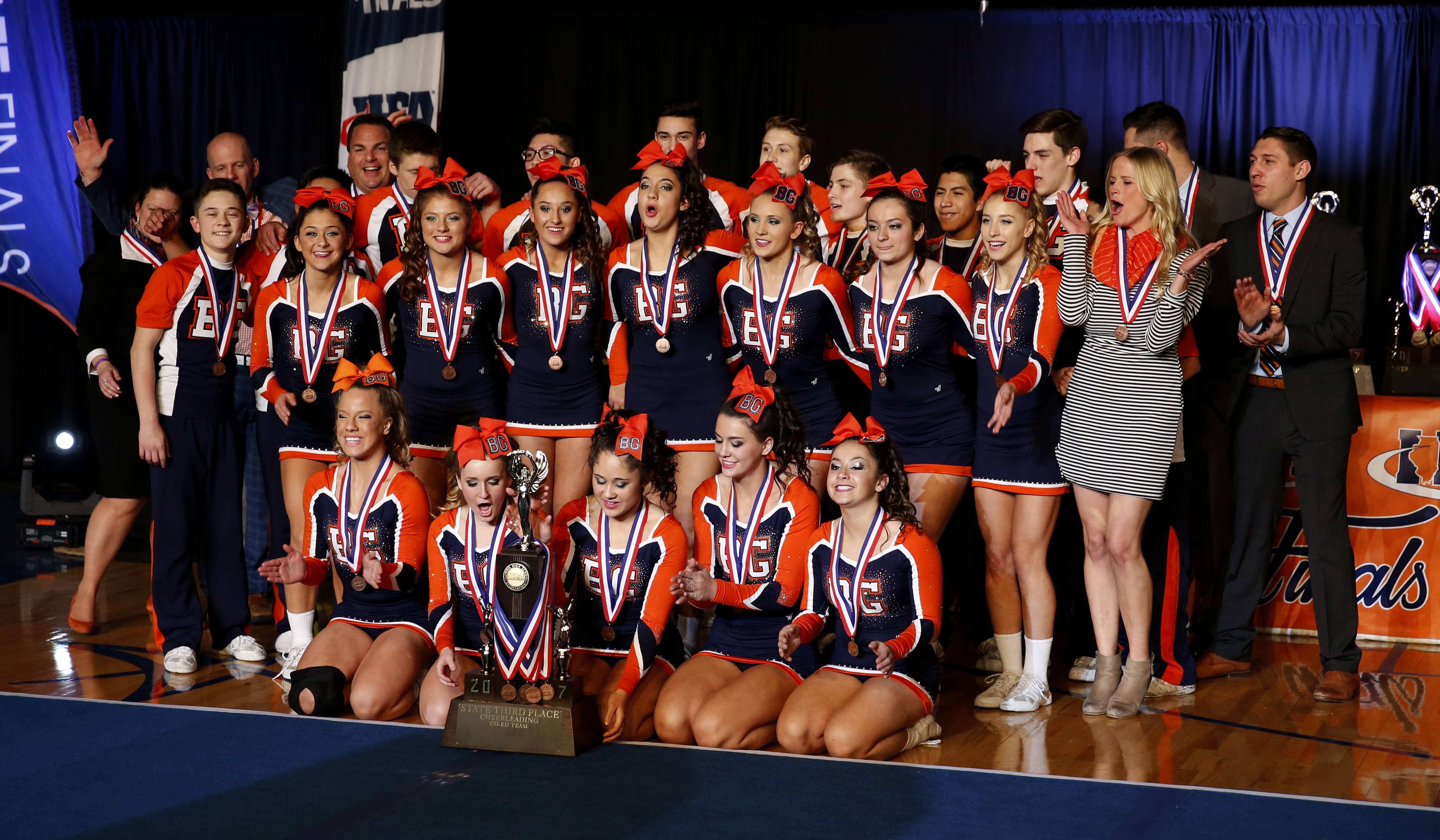Buffalo Grove cheerleaders celebrate a third-place finish in the coed division at the state finals Saturday at the U.S. Cellular Coliseum in Bloomington.