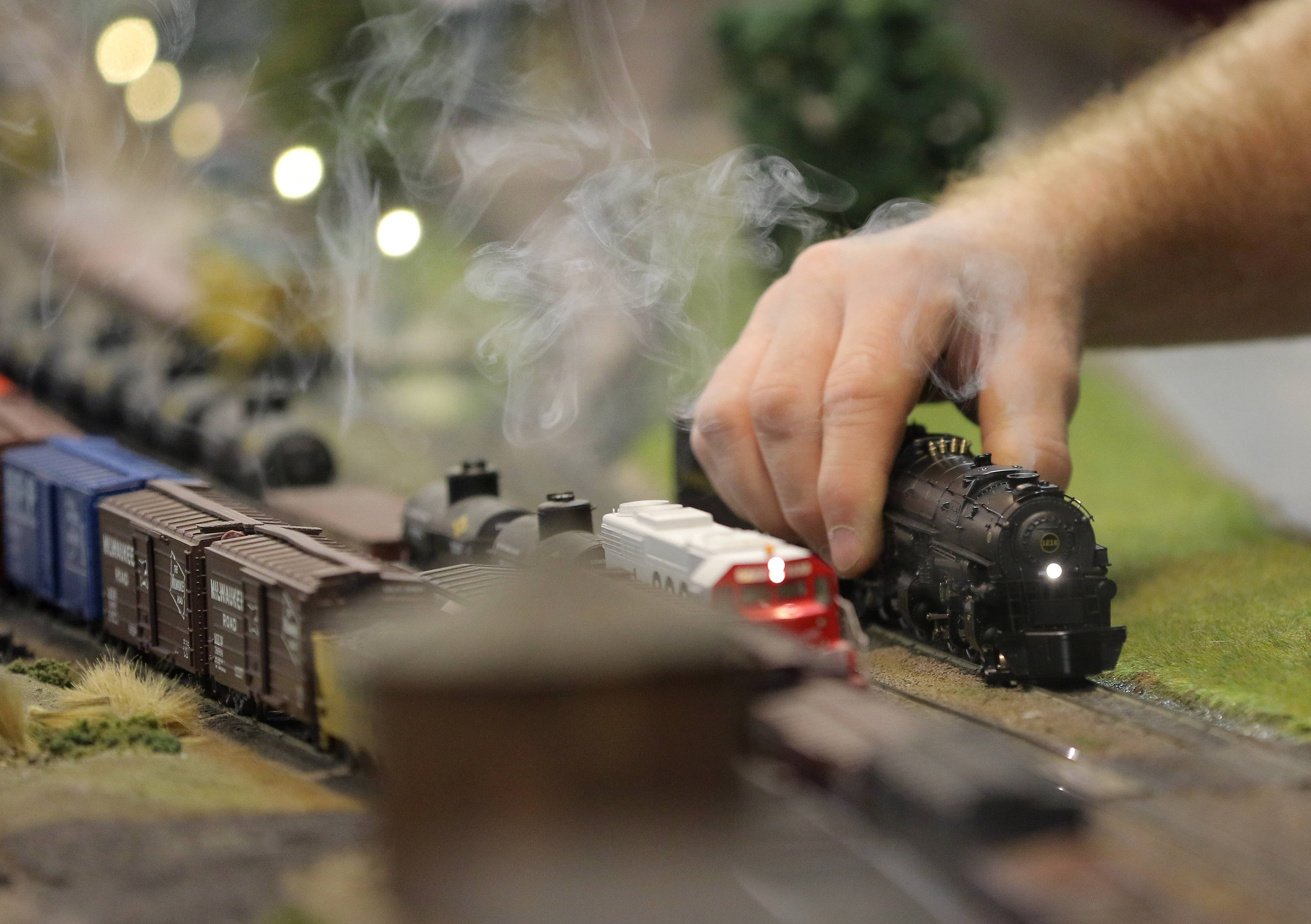 Rod Issacson of Wauconda adjusts his locomotive on the rails at the Lake County Model Railroad Club in Wauconda.