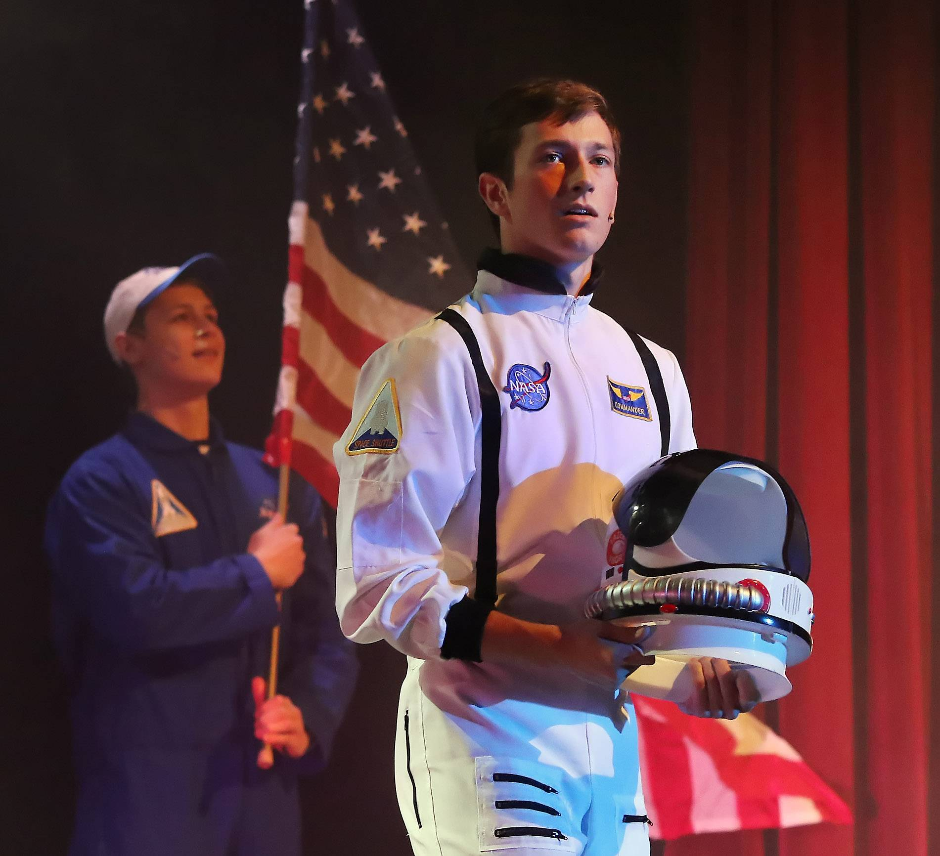 "Senior Mike Orsini plays an astronaut as he sings in the scene, ""Sky Full of Stars,"" during the production of ""The Final Quest; Ark of Light"" on Sunday at Carmel Catholic High School in Mundelein. The free performance for senior citizens was a preview of next weekends 43rd Annual Carmel Street Scenes."
