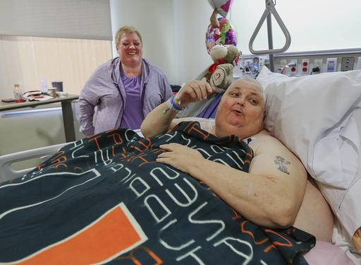 In this Feb. 2, 2017, photo, Kitty Logan stands by her husband Roger Logan as he rests on a bed at Bakersfield Memorial Hospital two days after he had his 130-pound tumor removed at the hospital in Bakersfield, Calif. Logan, a Mississippi man who was told he was simply fat, has had the 130-pound tumor removed during an operation in Bakersfield. (Henry A. Barrios/The Bakersfield Californian via AP)