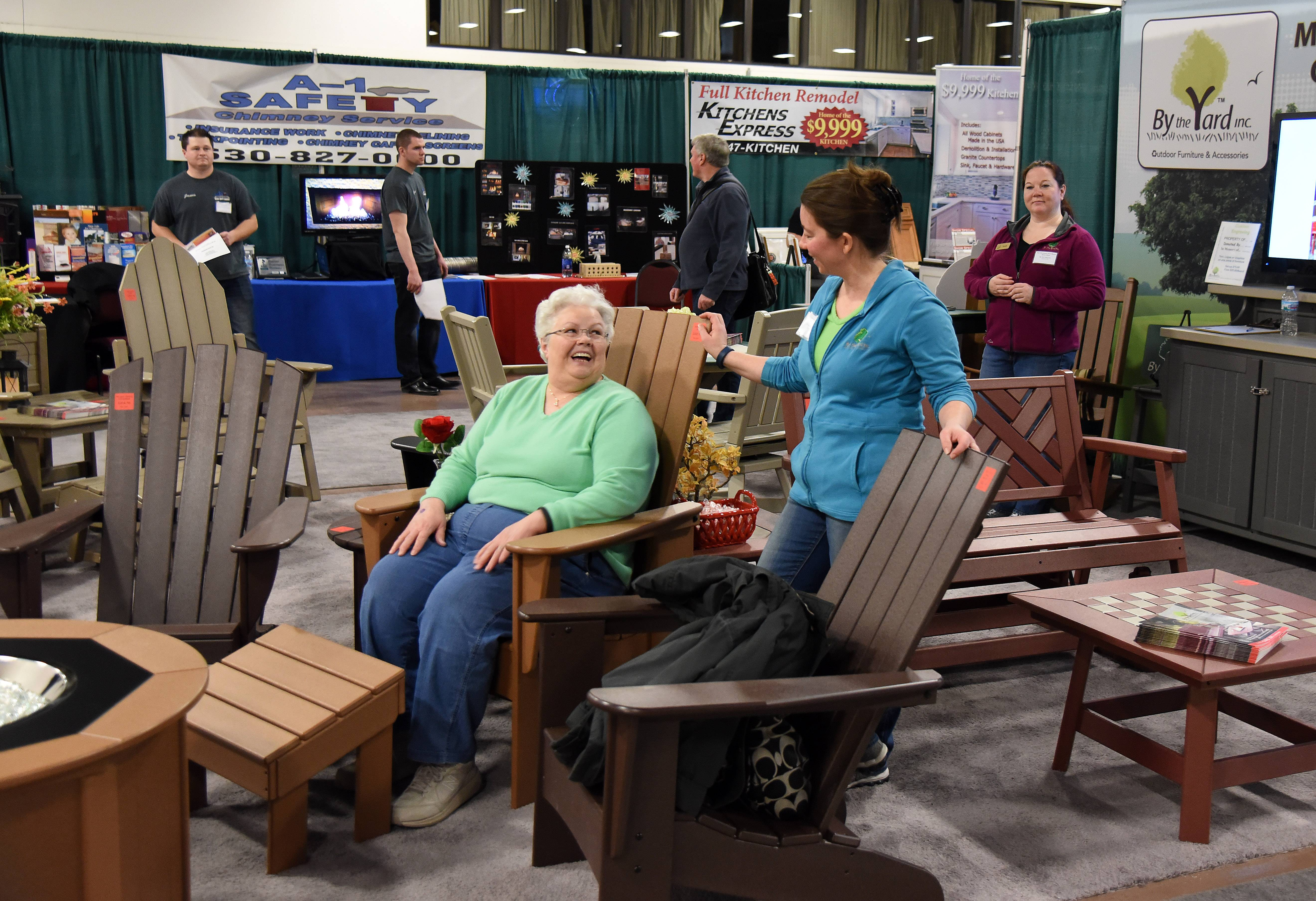 Kathy Lazzara of East Dundee checks out some all-weather outdoor furniture by By the Yard, Inc. at the Old House New House Show in St. Charles.