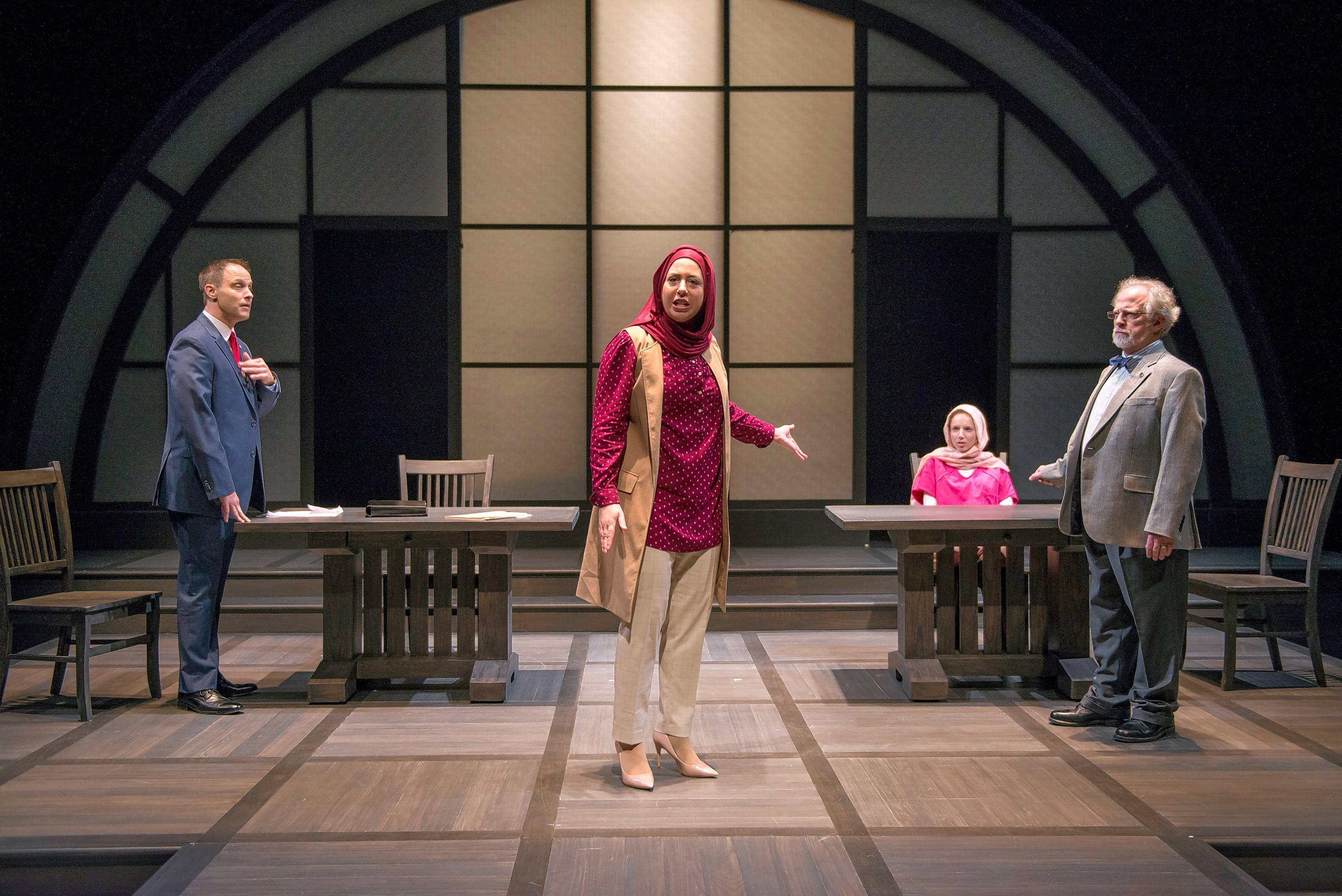 "Federal prosecutors Claire Fathi (Susaan Jamshidi), center, and Scott Bader (Timothy Edward Kane), left, present their case against suspected terrorist Susie Glenn (Lindsay Stock), seated, who's represented by Mark Arenberg (Ross Lehman) in Northlight Theatre's world premiere of ""Faceless"" a courtroom drama by Selina Fillinger."