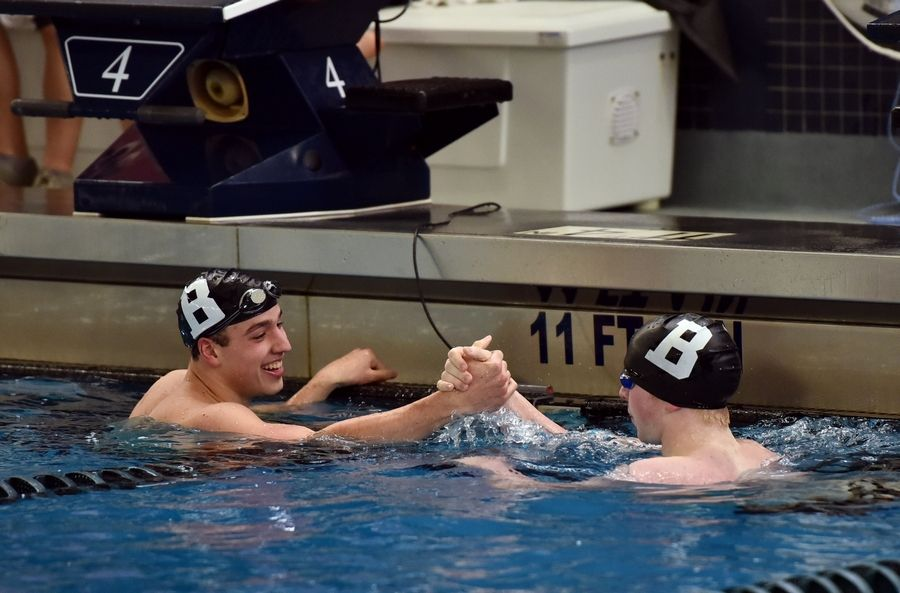 Barrington teammates John Lagoni and Mitch Gavars, right, congratulate one another after the 200-yard freestyle during the Mid-Suburban League meet at Conant on Saturday.