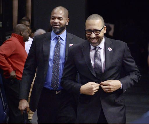 ADVANCE FOR USE SATURDAY, FEB. 11 - In this Feb. 8, 2017 photo, Memphis Grizzlies head coach David Fizdale, right, and associate head coach J. B. Bickerstaff walk to the court for an NBA basketball game against the Phoenix Suns in Memphis, Tenn. Fizdale and longtime friend Bickerstaff have teamed up in Memphis, and their chemistry is a big reason why the Grizzlies have been one of the surprise teams in the NBA this season.