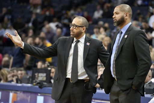 ADVANCE FOR USE SATURDAY, FEB. 11 - In this Feb. 8, 2017 photo, Memphis Grizzlies head coach David Fizdale, left, talks with associate head coach J. B. Bickerstaff during an NBA basketball game against the Phoenix Suns in Memphis, Tenn. Fizdale and longtime friend Bickerstaff have teamed up in Memphis, and their chemistry is a big reason why the Grizzlies have been one of the surprise teams in the NBA this season.