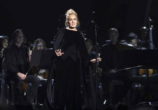 Adele performs a tribute to George Michael at the 59th annual Grammy Awards on Sunday, Feb. 12, 2017, in Los Angeles. (Photo by Matt Sayles/Invision/AP)