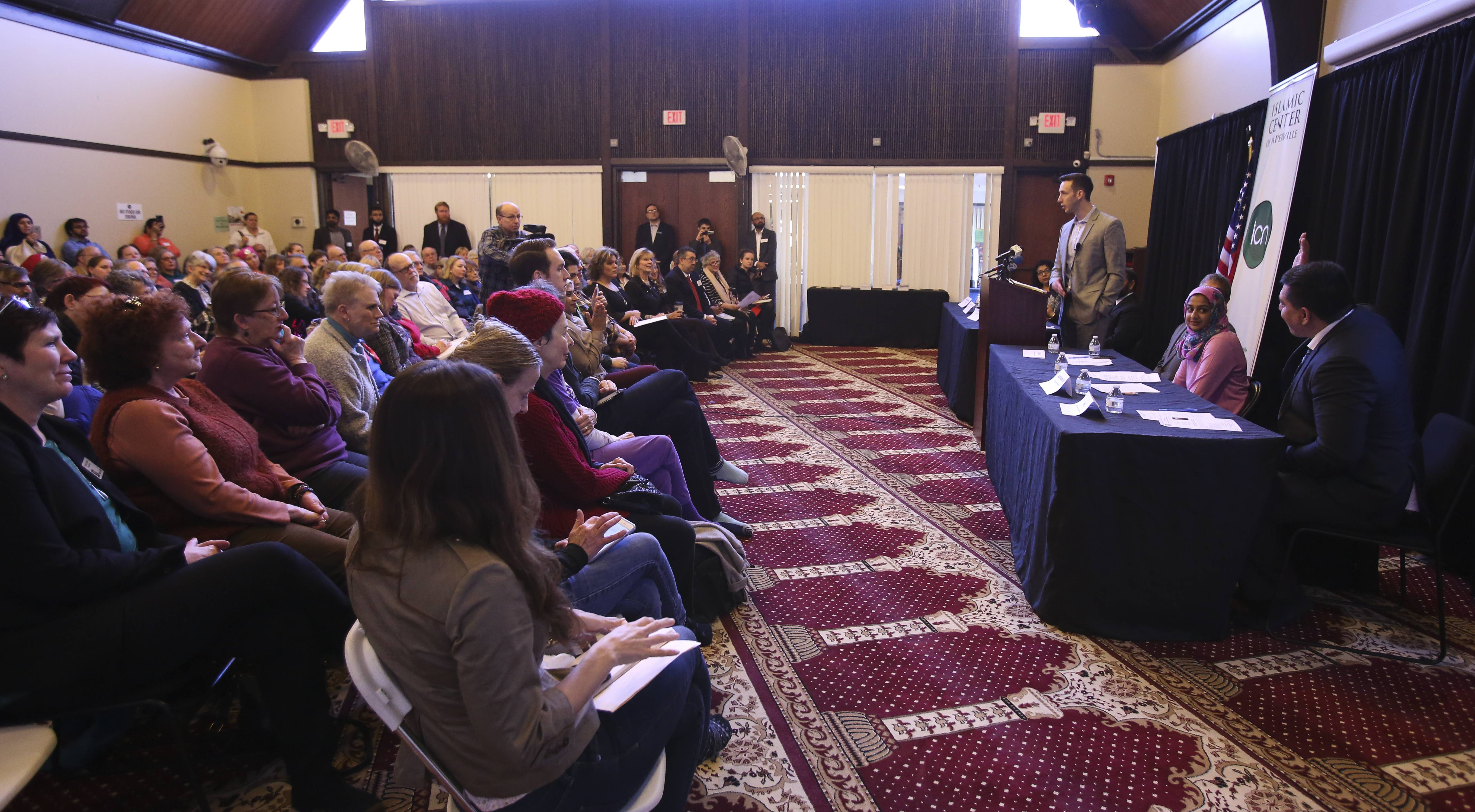 A crowd filled a prayer room at a Naperville mosque Monday for a discussion on immigration led by U.S. Rep. Bill Foster.