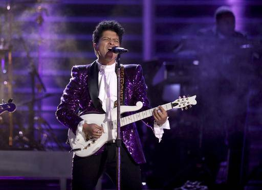 "Bruno Mars performs ""Let's Go Crazy"" during a tribute to Prince at the 59th annual Grammy Awards on Sunday, Feb. 12, 2017, in Los Angeles. (Photo by Matt Sayles/Invision/AP)"