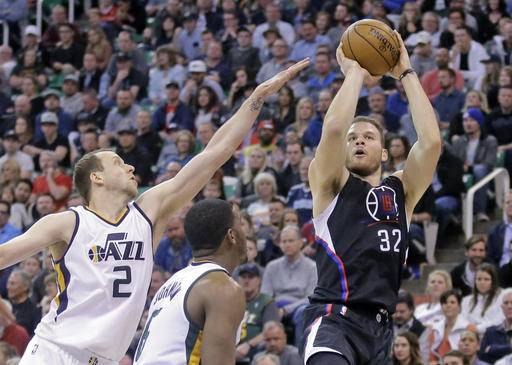 LA Clippers forward Blake Griffin (32) shoots as Utah Jazz forward Joe Ingles (2) defends in the first half during an NBA basketball game Monday, Feb. 13, 2017, in Salt Lake City. (AP Photo/Rick Bowmer)