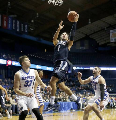 Villanova 's Jalen Brunson (1) drives and scores past DePaul 's Joe Hanel (33) and Chris Harrison-Docks (51) during the second half of an NCAA college basketball game Monday, Feb. 13, 2017, in Rosemont, Ill. Villanova won 75-62. (AP Photo/Charles Rex Arbogast)