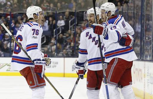 New York Rangers' Kevin Hayes, right, celebrates his goal against the Columbus Blue Jackets with teammates Brady Skjei, left, and Kevin Klein during the third period of an NHL hockey game Monday, Feb. 13, 2017, in Columbus, Ohio. The Rangers beat the Blue Jackets 3-2. (AP Photo/Jay LaPrete)
