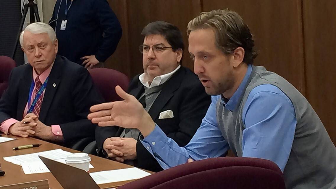 Lake County Board Chairman Aaron Lawlor, right, wants to let voters decide if they should elect the chairman. Here he talks to a county board committee about the proposal last week.