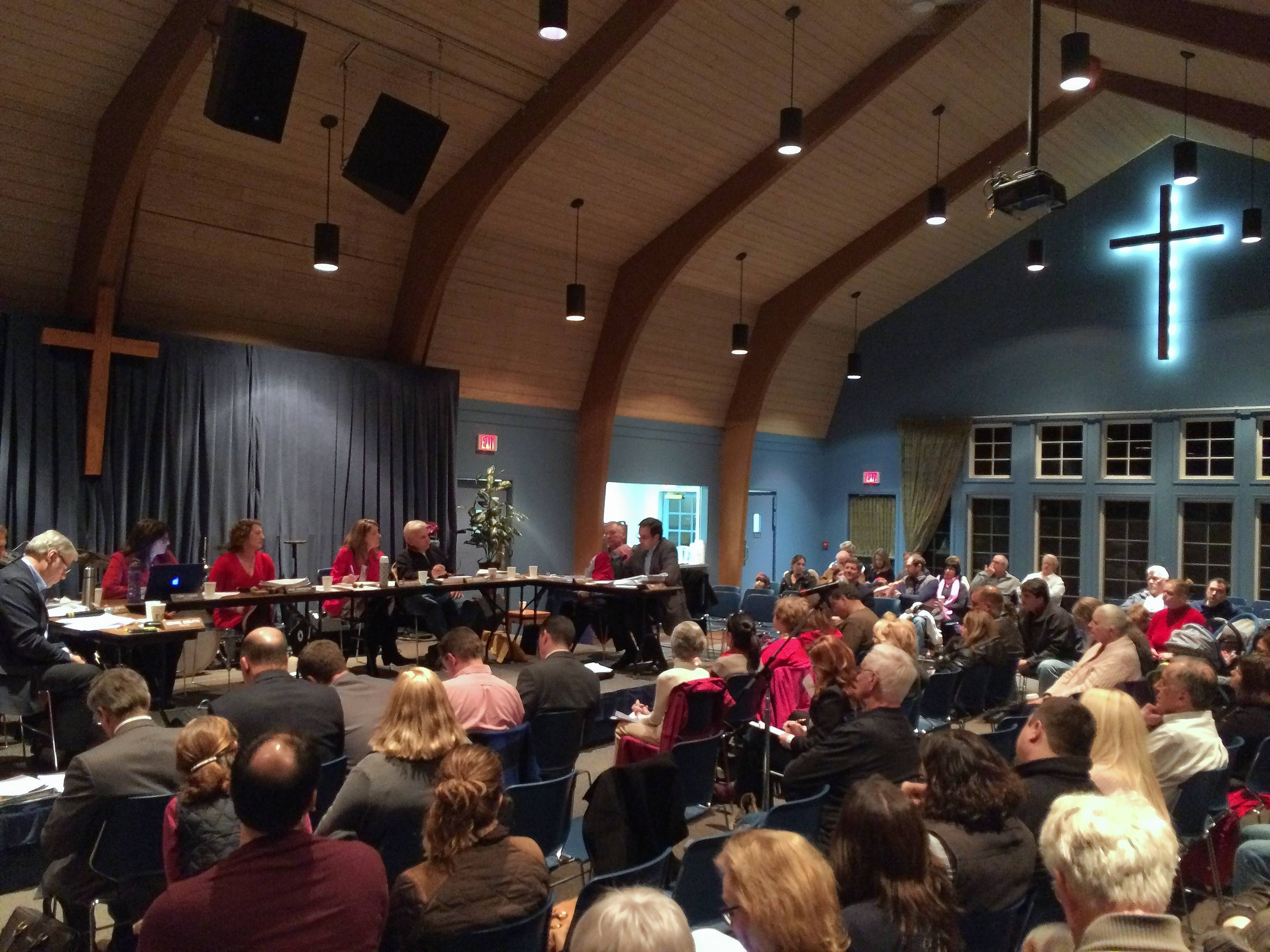 About 150 spectators attended a Long Grove village board meeting that featured discussion on the future of the iconic covered bridge at the downtown entry from the west. The meeting was shifted from village hall to Long Grove Community Church's community house.