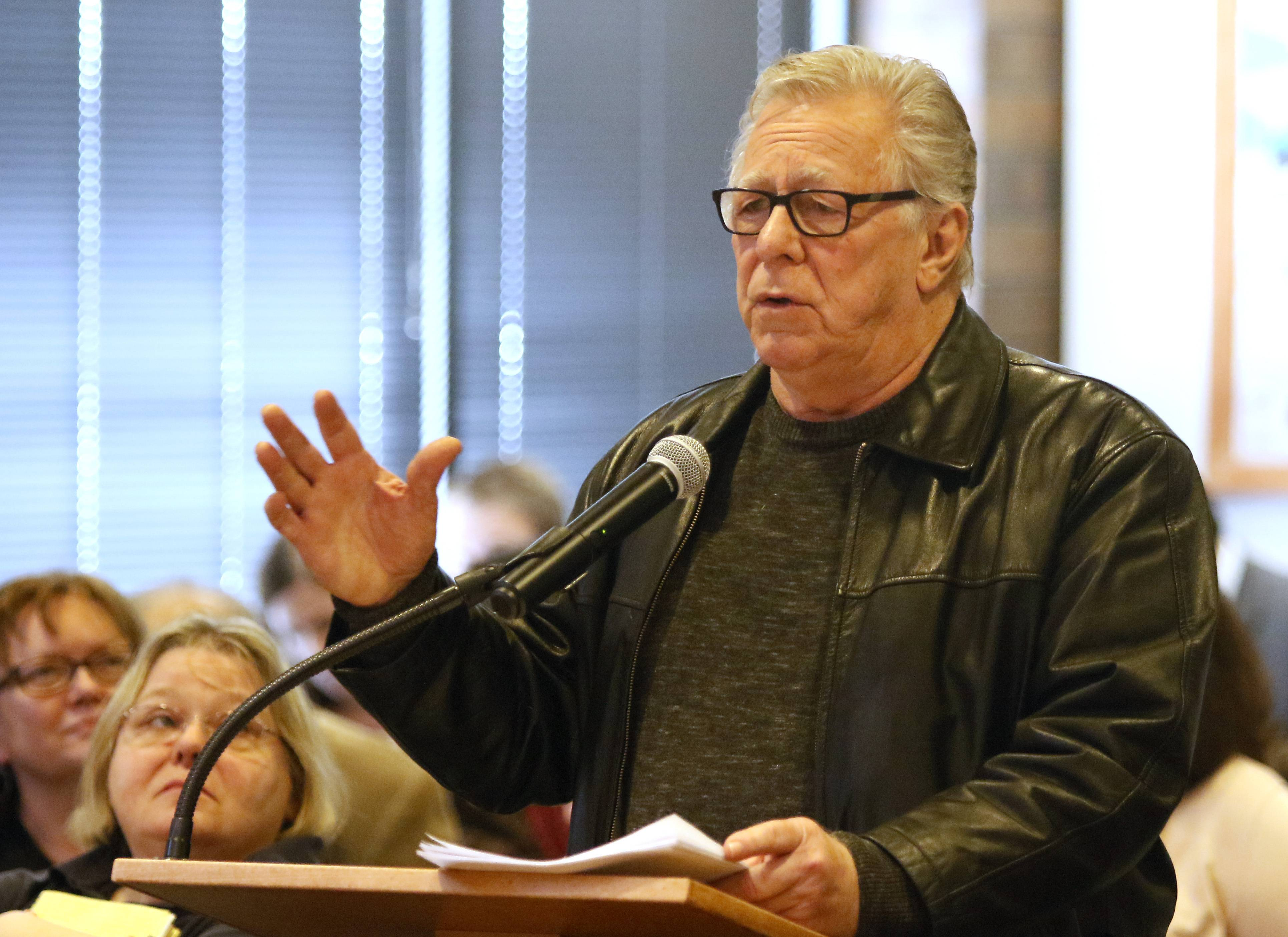 "Robert Peickert, chairman of the DuPage Democratic Party, says he doesn't believe a proposed merger of the DuPage Election Commission and the county clerk's office will save money. ""It looks good for the people proposing this,"" he said, ""but this is not true consolidation."""