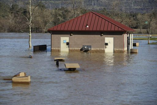 The Latest: Officials: Dam water level continues to drop