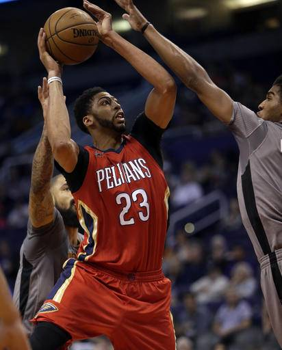 New Orleans Pelicans forward Anthony Davis (23) shoots in front of Phoenix Suns forward Marquese Chriss in the second quarter during an NBA basketball game, Monday, Feb. 13, 2017, in Phoenix. (AP Photo/Rick Scuteri)