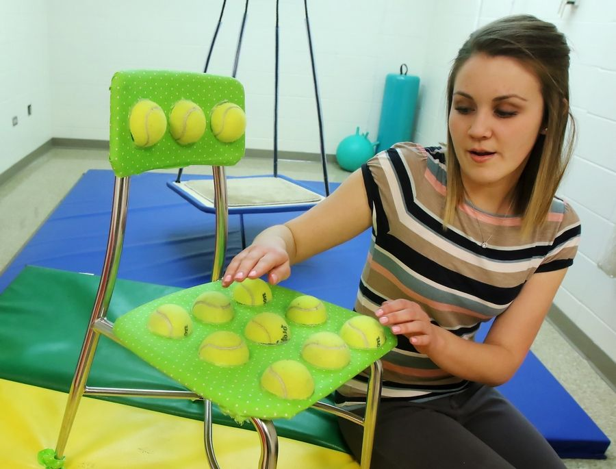 Speech language pathologist Amy Maplethorpe talks about a tennis ball sensory chair she designed and is using at Raymond Ellis Elementary School in Round Lake. The specially designed chair helps children with special needs and has become a Facebook sensation, reaching at least 15 million people over social media.
