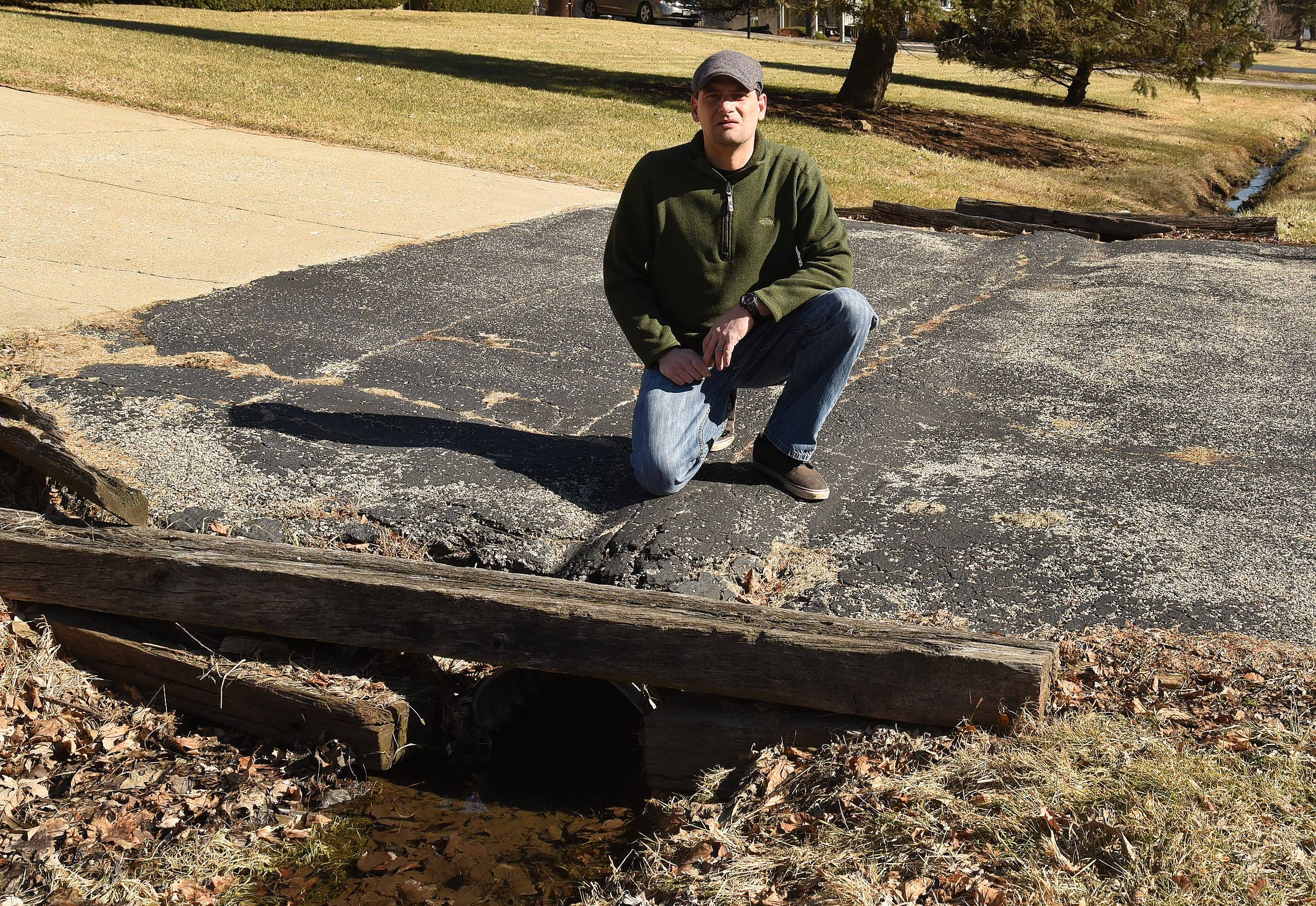 Henry Kolff said he refused to pay Dundee Township Highway Commissioner Larry Braasch to replace his culvert, so the work wasn't done. Several neighboring townships replace culverts at no charge.