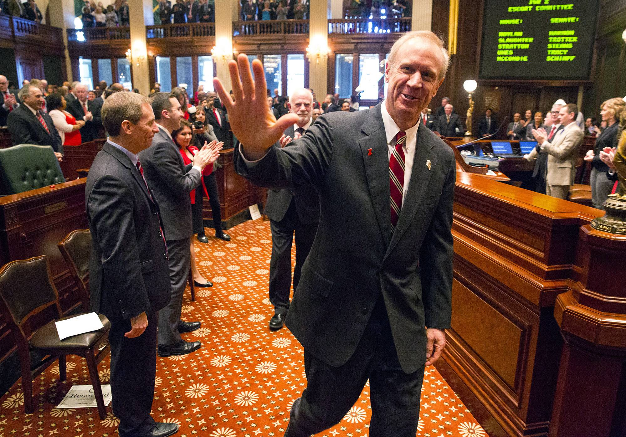 Illinois Gov. Bruce Rauner acknowledges lawmakers as he prepares to deliver his budget address at the Capitol Wednesday.