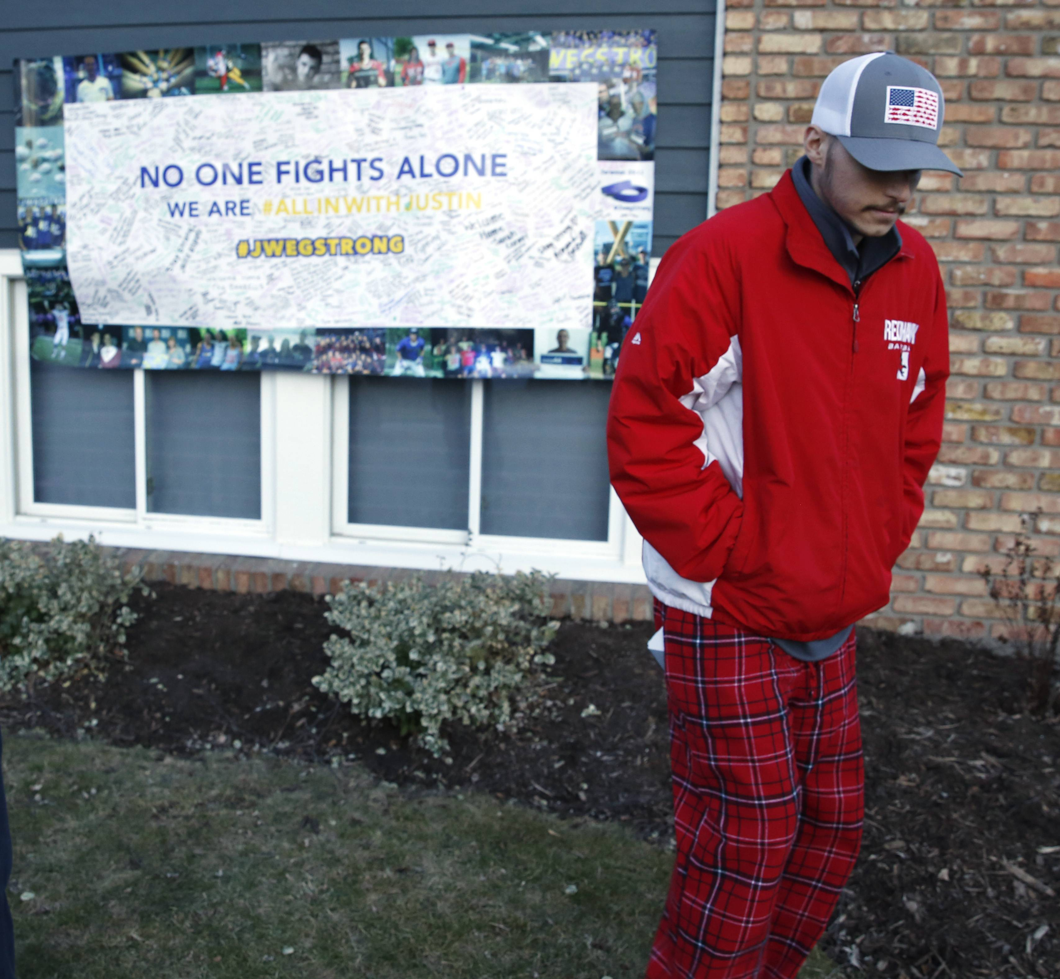 Justin Wegner, 20, of Naperville, returned home from cancer treatment in Texas on Wednesday to a group of neighbors and friends forming a parade.