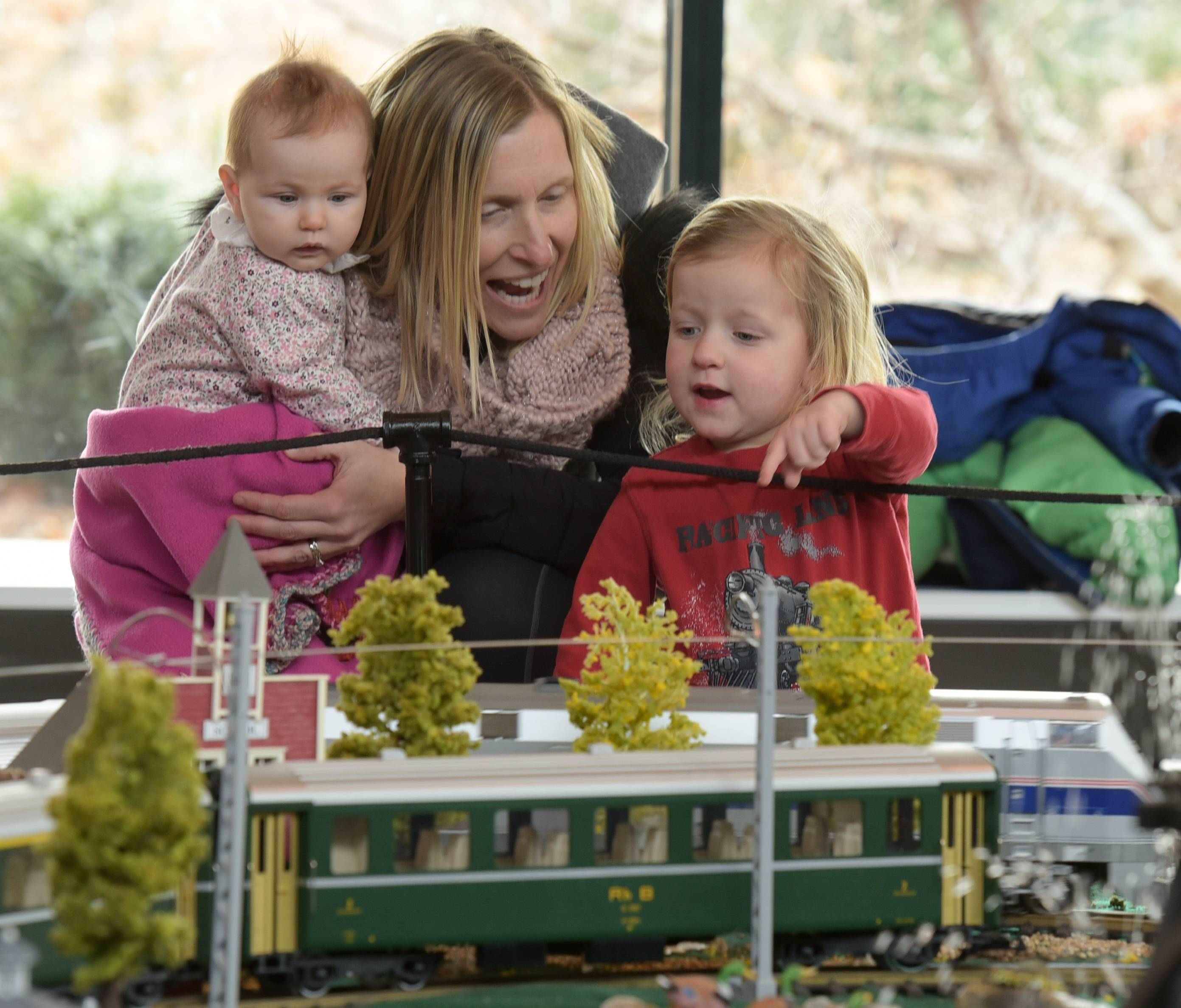 Valerie Guglielmi visits the Enchanted Railroad display at the Morton Arboretum in Lisle with her daughter Lydia, 5 months, and son Henry, 4.