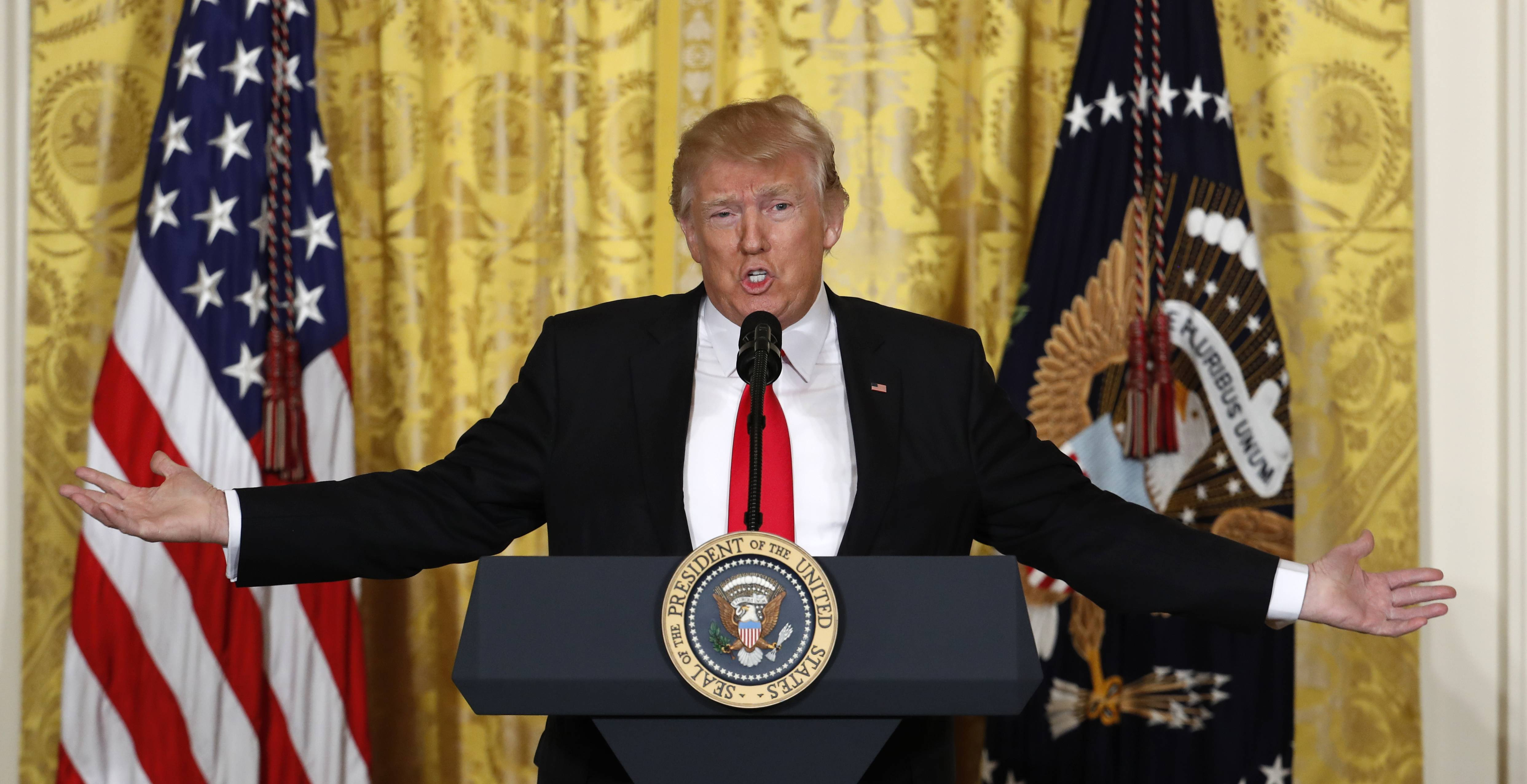 President Donald Trump speaks in a wide-ranging news conference Thursday in the East Room of the White House in Washington.