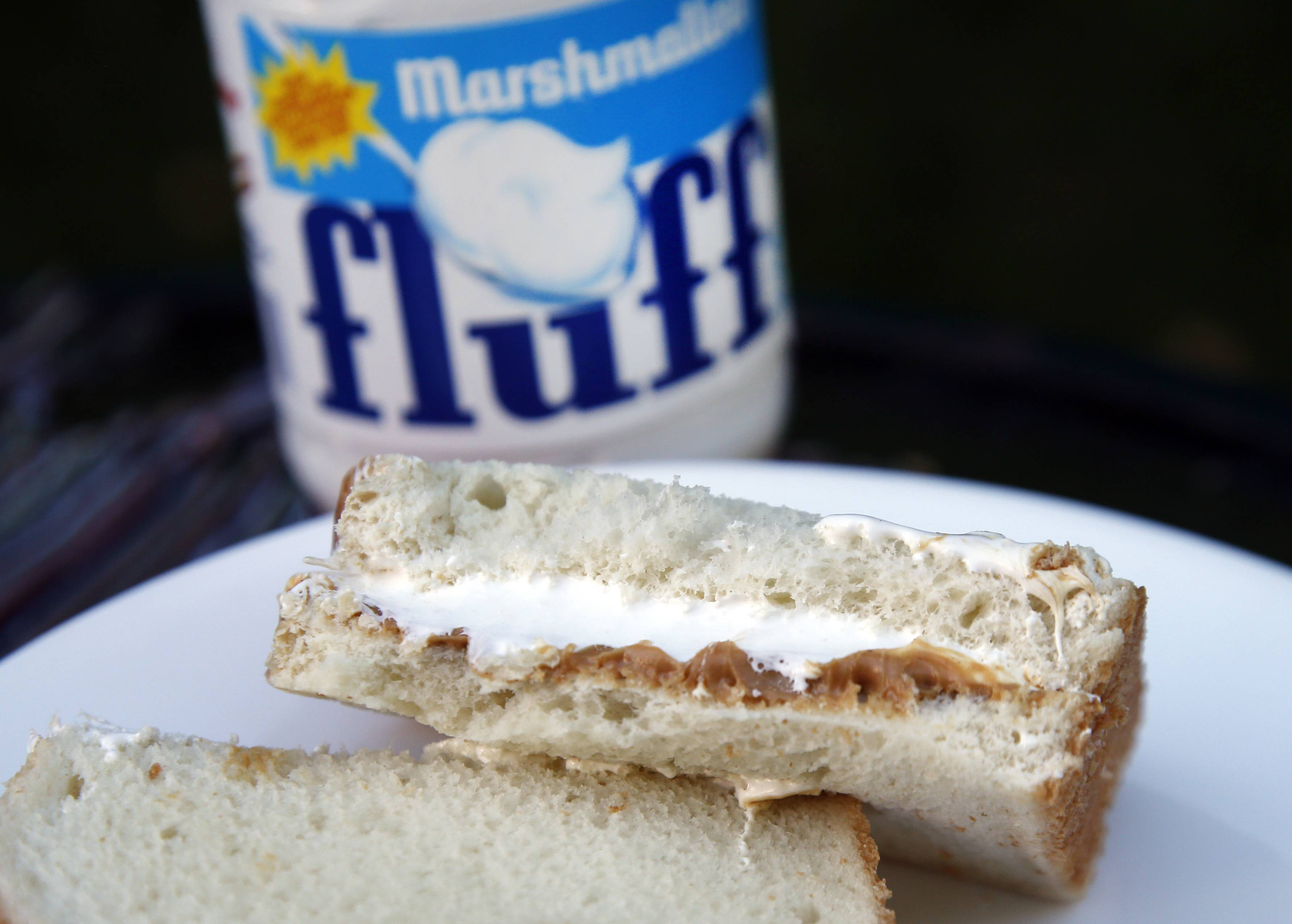 A jar of Marshmallow Fluff leads to a Fluffernutter sandwich. The marshmallow concoction that's been smeared on a century's worth of sandwiches has inspired a festival and other sticky remembrances as it turns 100 in 2017.