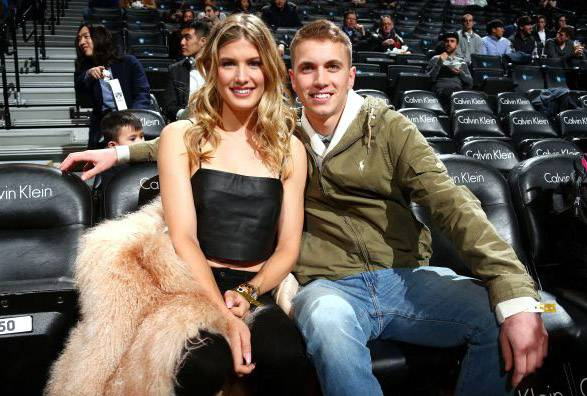 Canadian tennis pro Eugenie Bouchard, left, and John Goehrke, a college student from Vernon Hills, pose at a Brooklyn Nets game Wednesday. Bouchard honored her word to go on a date with Goehrke if the New England Patriots came back to win the Super Bowl.