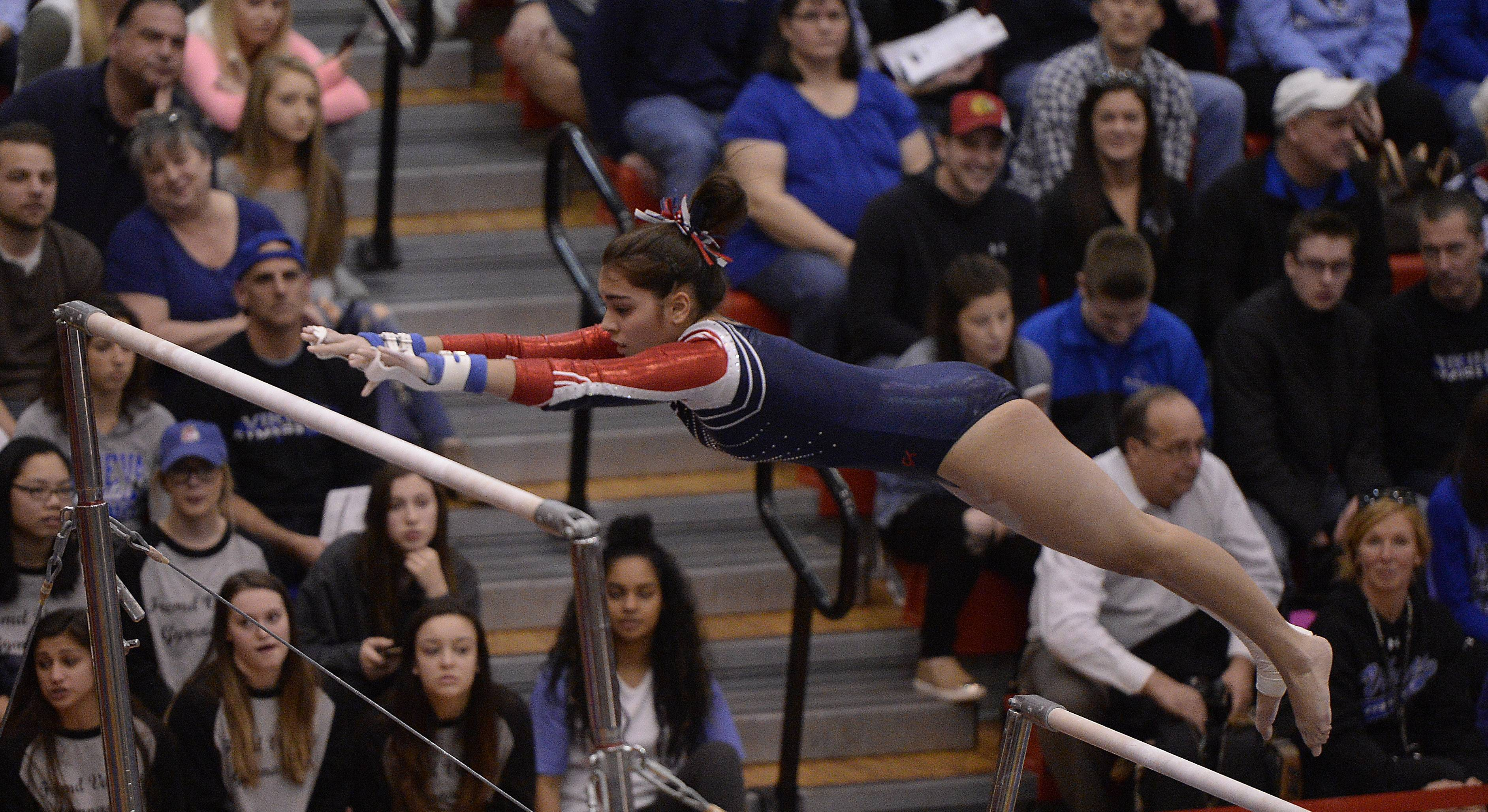 Conant's Melynda Meyrick on the uneven parallel bars during state gymnastics at Palatine High School on Friday.