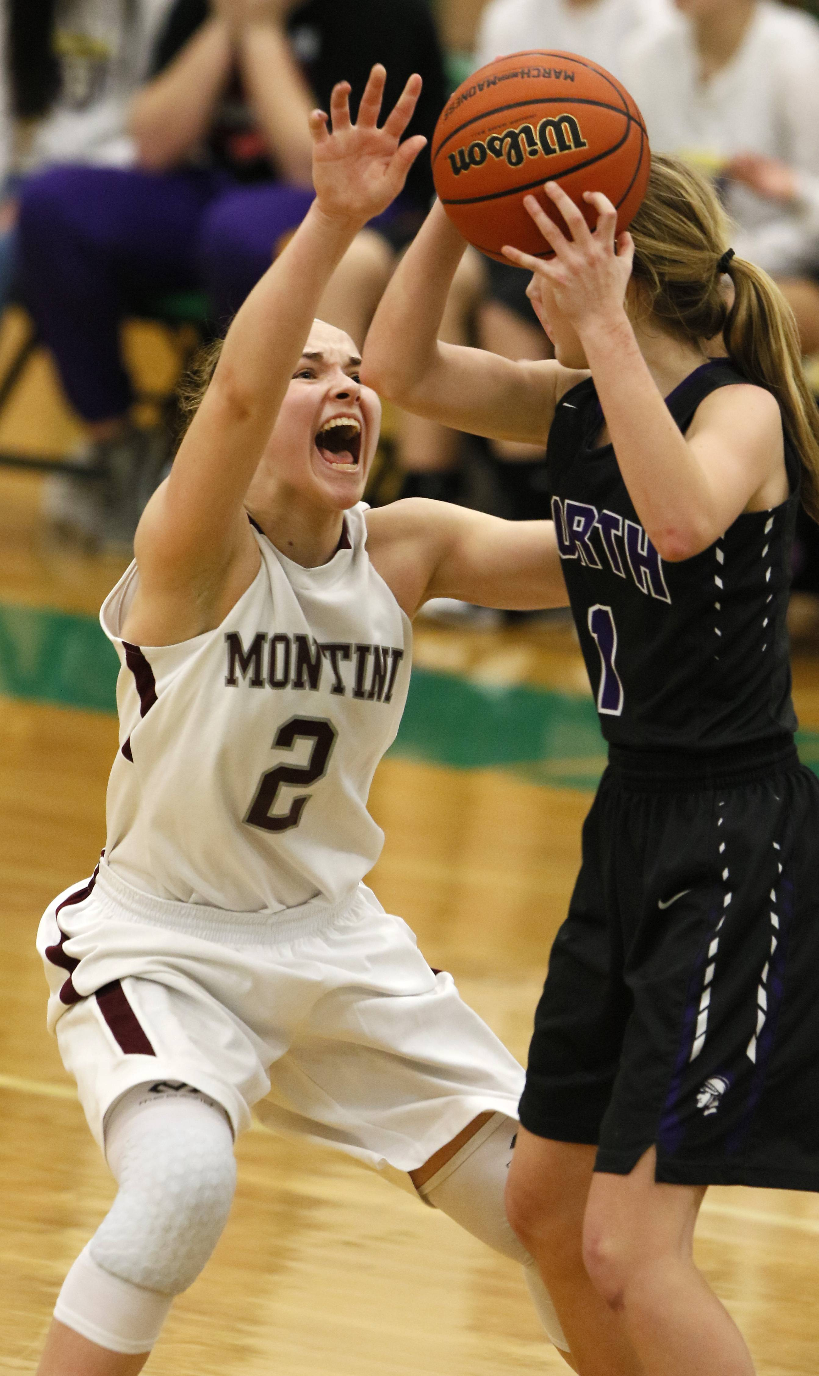 Montini Catholic's Sam Mitchell, left, defends against Downers Grove North's Ellie Gross, right, during the Class 4A Oak Lawn regional girls basketball game.