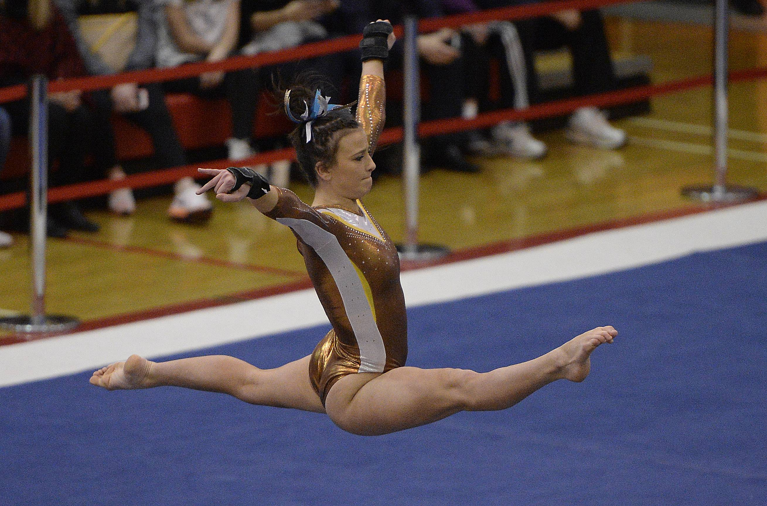 Carmel's Samantha Lococo on the floor during state gymnastics at Palatine High School on Friday.