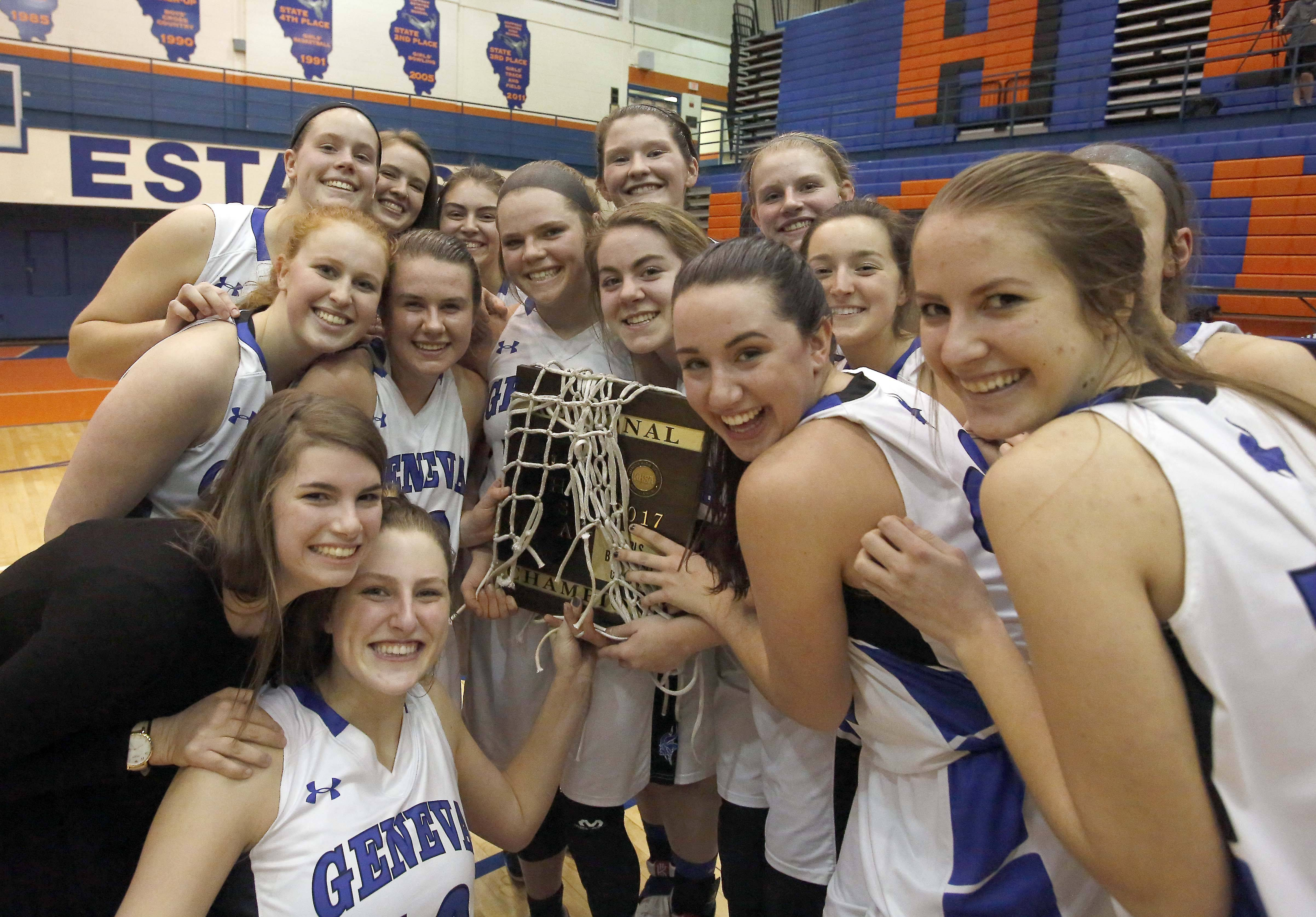 Geneva celebrates their victory over York at the IHSA Class 4A Hoffman Estates girls basketball regional final.
