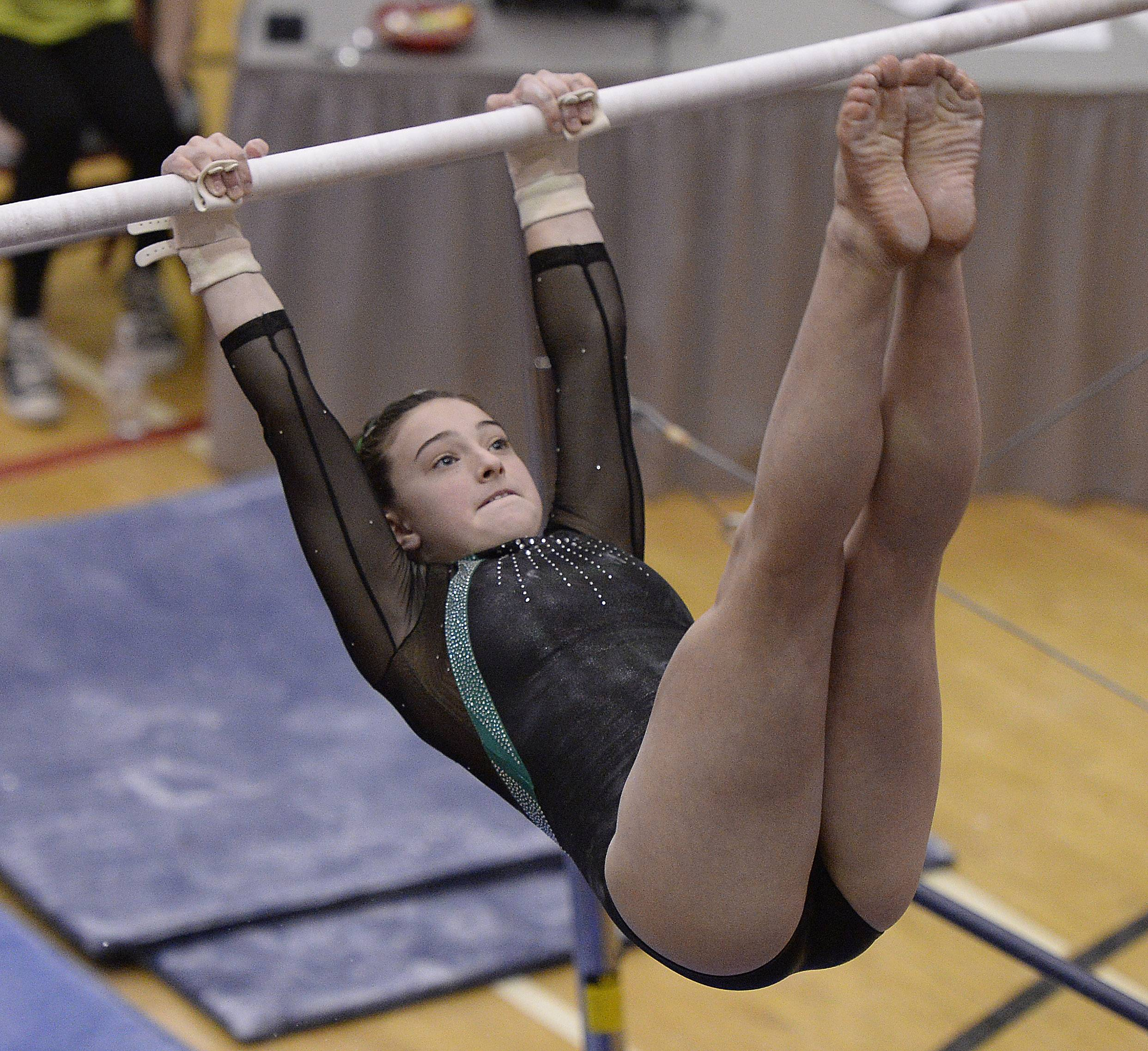 Glenbard West's Maddie Diab on the uneven parallel bars during state gymnastics at Palatine High School on Friday.