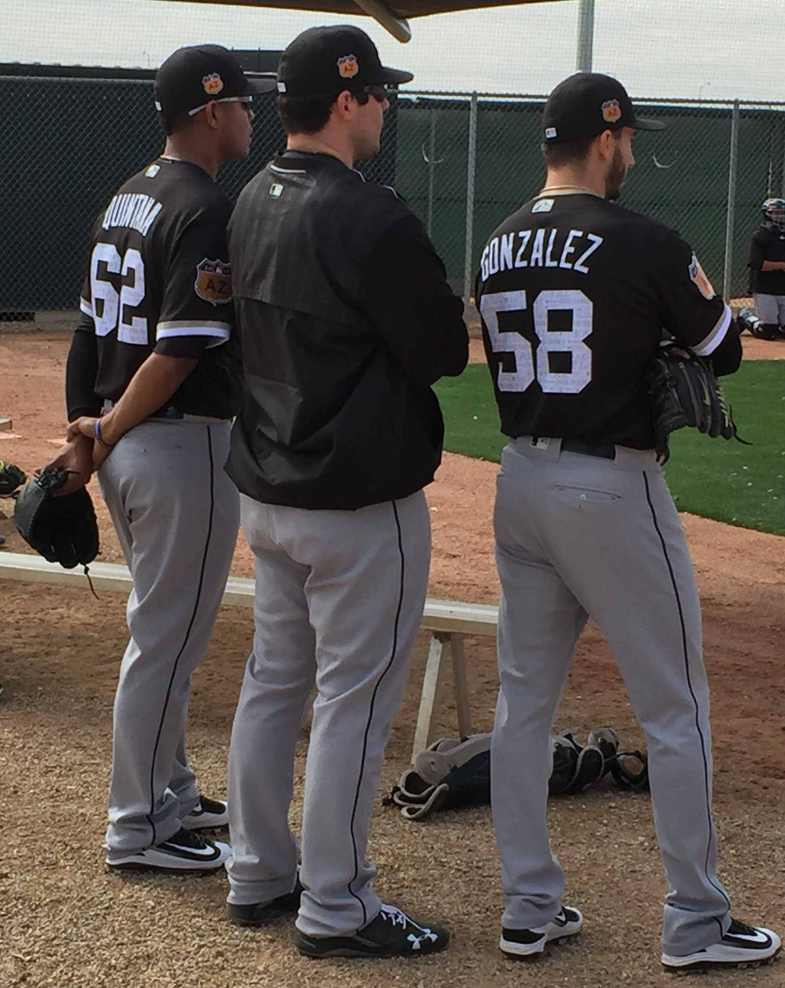 White Sox lefty Carlos Rodon, middle, watches Friday's bullpen session with starters Miguel Gonzalez and Jose Quintana.
