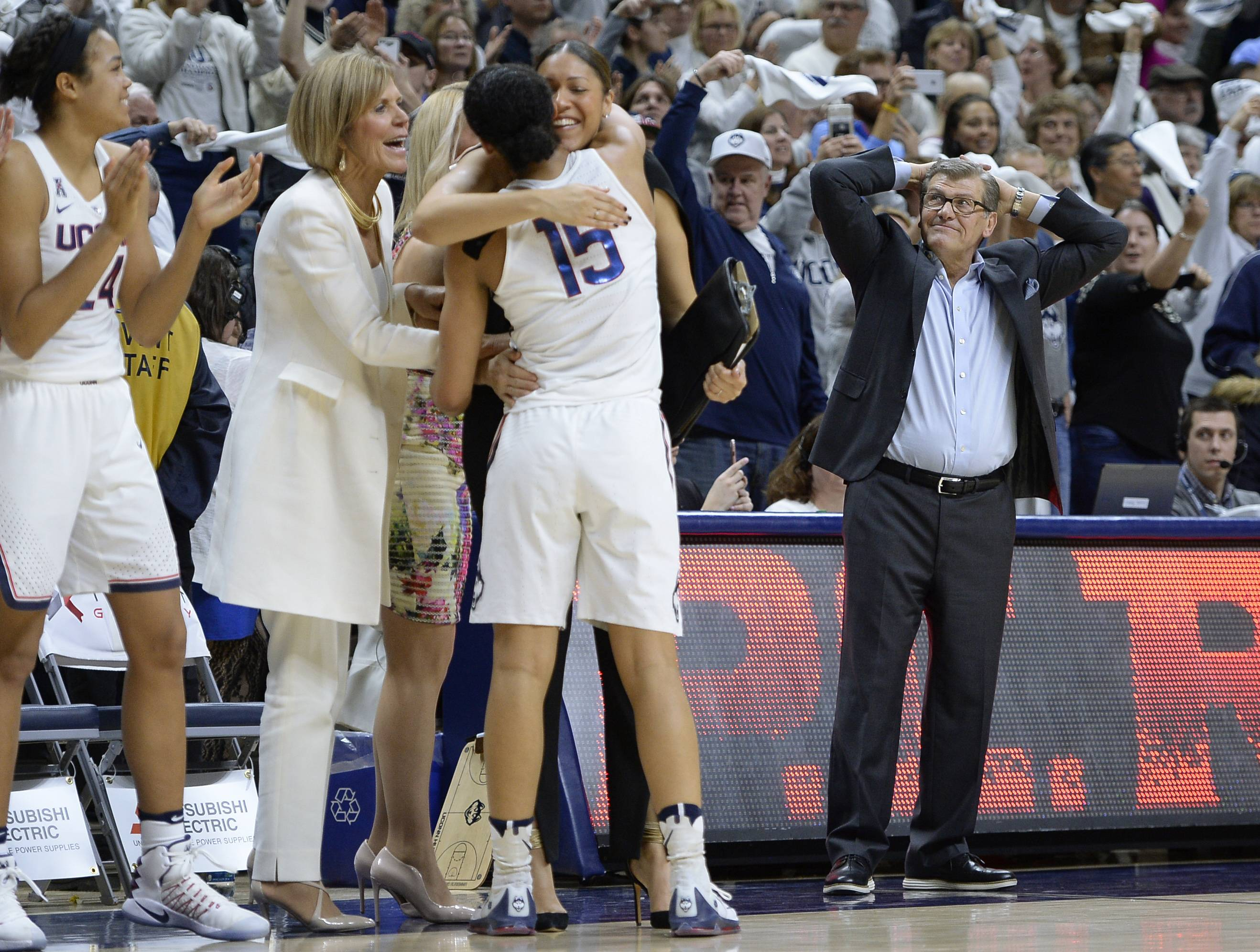 Connecticut head coach Geno Auriemma, right, reacts as Connecticut's Gabby Williams (15) is congratulated by associated head coach Chris Dailey and embraced by assistant coach Marisa Moseley at the end of their game against South Carolina, Monday, in Storrs, Conn. The win was UConn's 100th straight. Some don't want to give the Connecticut women's basketball team its due for 100 straight wins. Winning 100 straight games is an amazing accomplishment for any team at any level.
