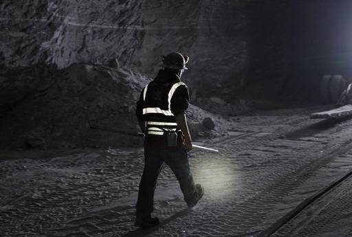 In this Jan. 27, 2017 photo, American Rock Salt Co. worker Bill Rossborough walks through the mine in Hampton Corners, N.Y. More than 1,200 feet below farm country in upstate New York the company mines a seam of salt left from a massive sea that dried up 400 million years ago. The deposit is accessible today by an elevator that descends as deep as the Empire State Building is high.