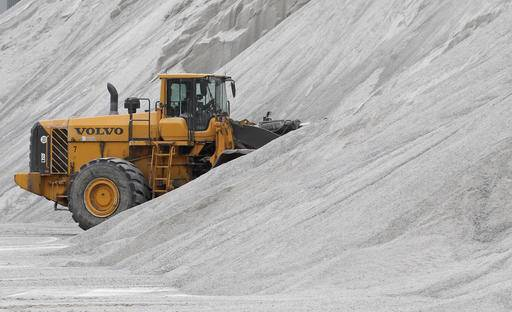 In this Jan. 27, 2017 photo, an American Rock Salt Co., loader works a salt pile at the  road salt mine in Hampton Corners, N.Y. More than 1,200 feet below farm country in upstate New York, the company mines a seam of salt left from a massive sea that dried up 400 million years ago.