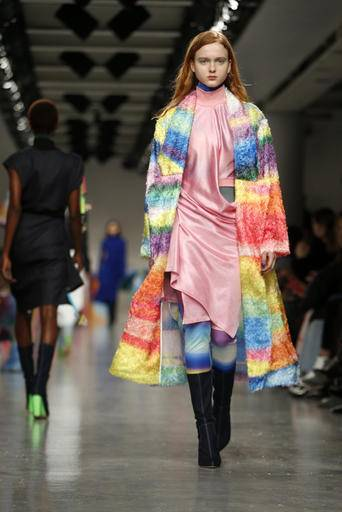 A model wears a creation by designer Fydor Golan during their runway show as part of London Fashion Week, Friday, Feb. 17, 2017.