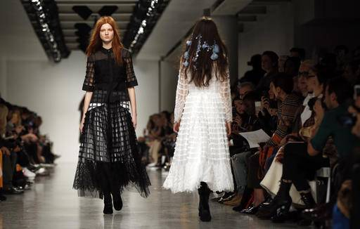 Models wear creations by designer Bora Aksu during the runway show as part of London Fashion Week, Friday, Feb. 17, 2017.