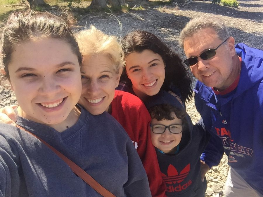 The Crawford family of Arlington Heights: From left, Hailee, 15; mother Anita; Kirsten, 20, above Christian, 10; and father Kevin. Anita, Kirsten and Kevin died in an auto crash Thursday night.