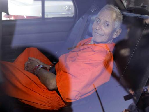 "FILE - In March 17, 2015, file photo, New York real estate heir Robert Durst smiles as he is transported from Orleans Parish Criminal District Court to the Orleans Parish Prison after his arraignment on murder charges in New Orleans. Durst's close friend Nathan Chavin said Friday, Feb. 17, 2017, that it took seven months for him to come clean and tell prosecutors what the real estate heir said about killing their close friend. Chavin said he struggled during that time to balance his loyalties to two best friends before deciding to tell ""the whole truth"" about what he knew about Susan Berman's death. (AP Photo/Gerald Herbert, File)"