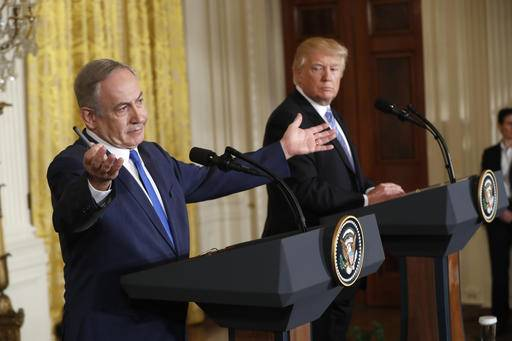 FILE - In this Wednesday, Feb. 15, 2017 file photo, President Donald Trump and Israeli Prime Minister Benjamin Netanyahu give a joint news conference in the East Room of the White House in Washington. The debate among American Jews over President Donald Trump has become as raucous as the first weeks of the Trump administration itself, hardening divisions between liberal and conservative Jews that have been growing for years. (AP Photo/Pablo Martinez Monsivais)